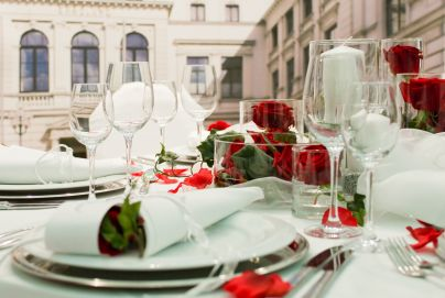 7670425 - covered banquet with red roses decoration